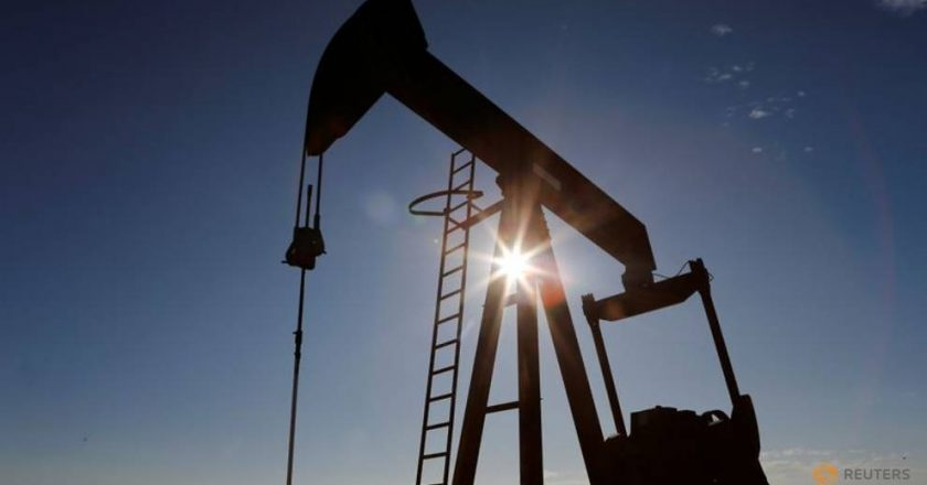 Oil prices slide on concerns about patchy demand recovery, record US stocks
